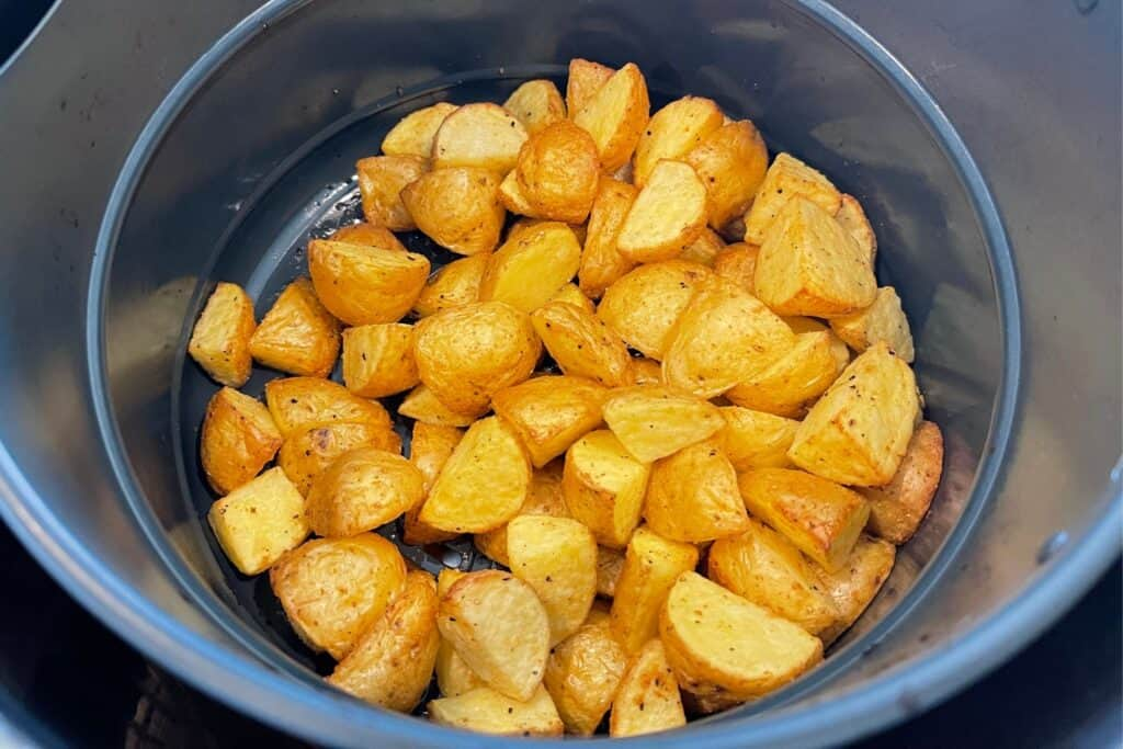 quartered baby gold potatoes in the air fryer basket