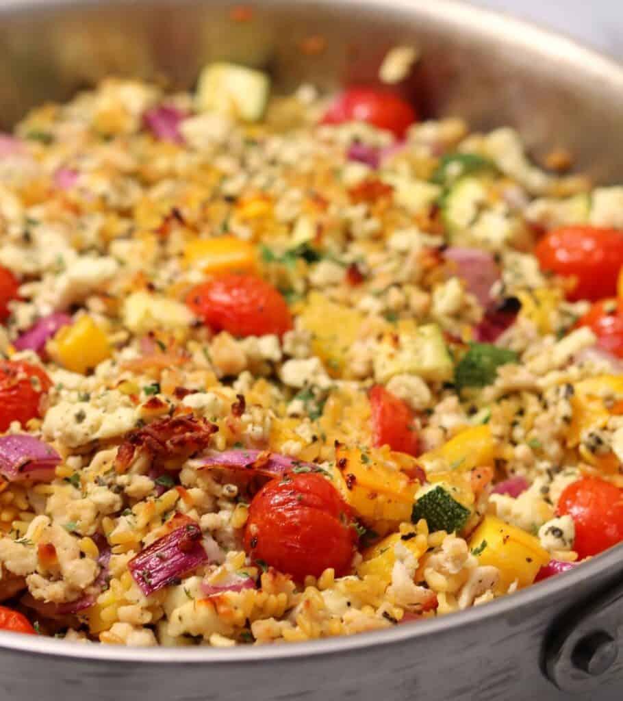 skillet with ground chicken, veggies, and rice