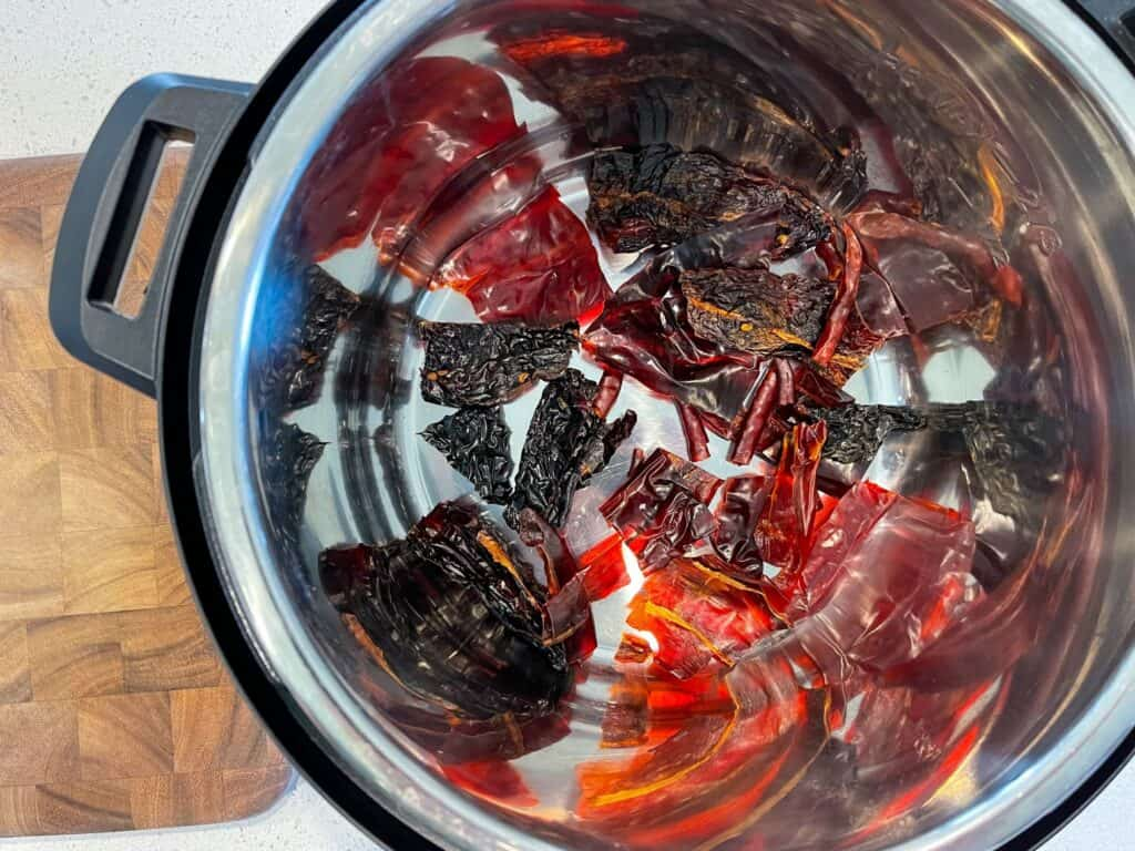 toasting guajillo, ancho, and arbol chiles in an Instant Pot