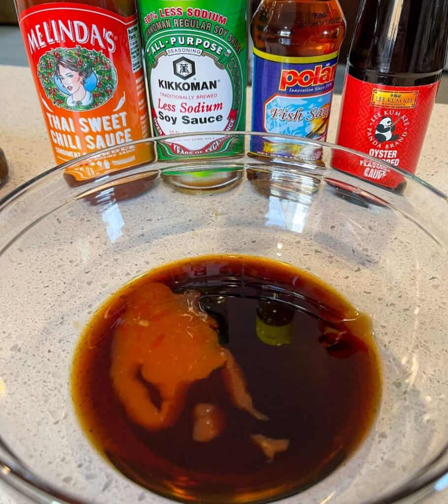 oyster sauce, fish sauce, sweet chili sauce, and soy sauce in a bowl