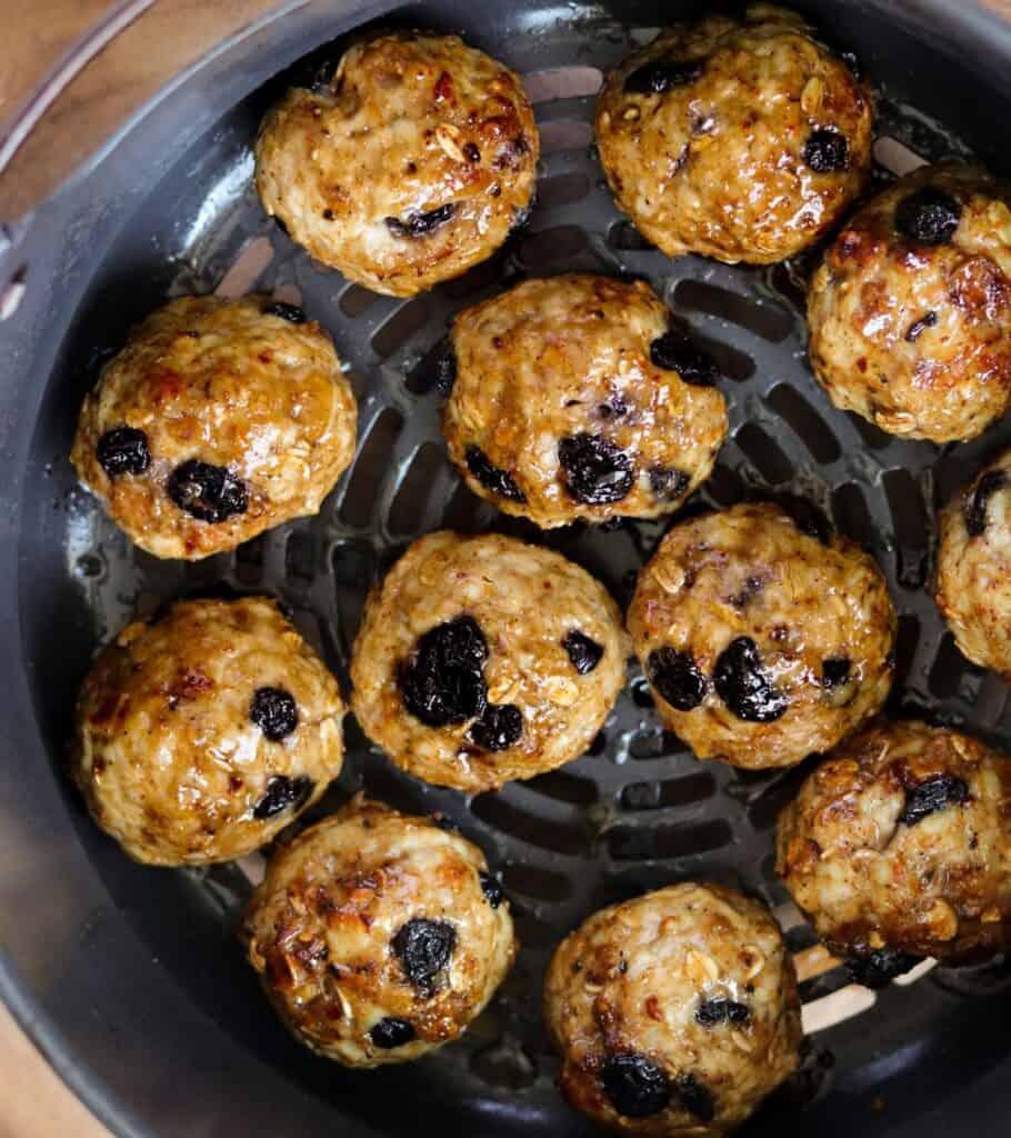 maple glazed breakfast meatballs in an air fryer basket