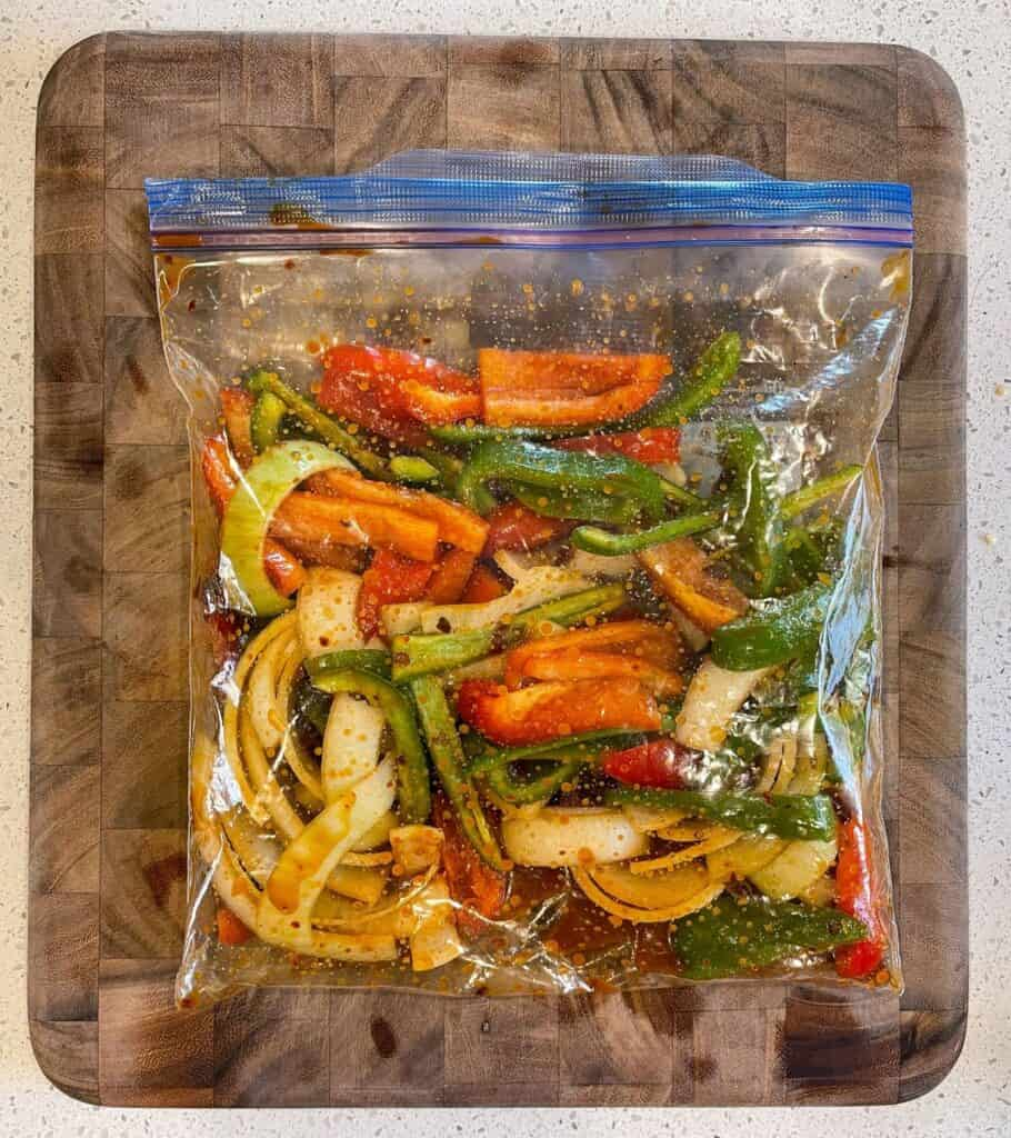 fajita vegetables in a resealable bag with marinade