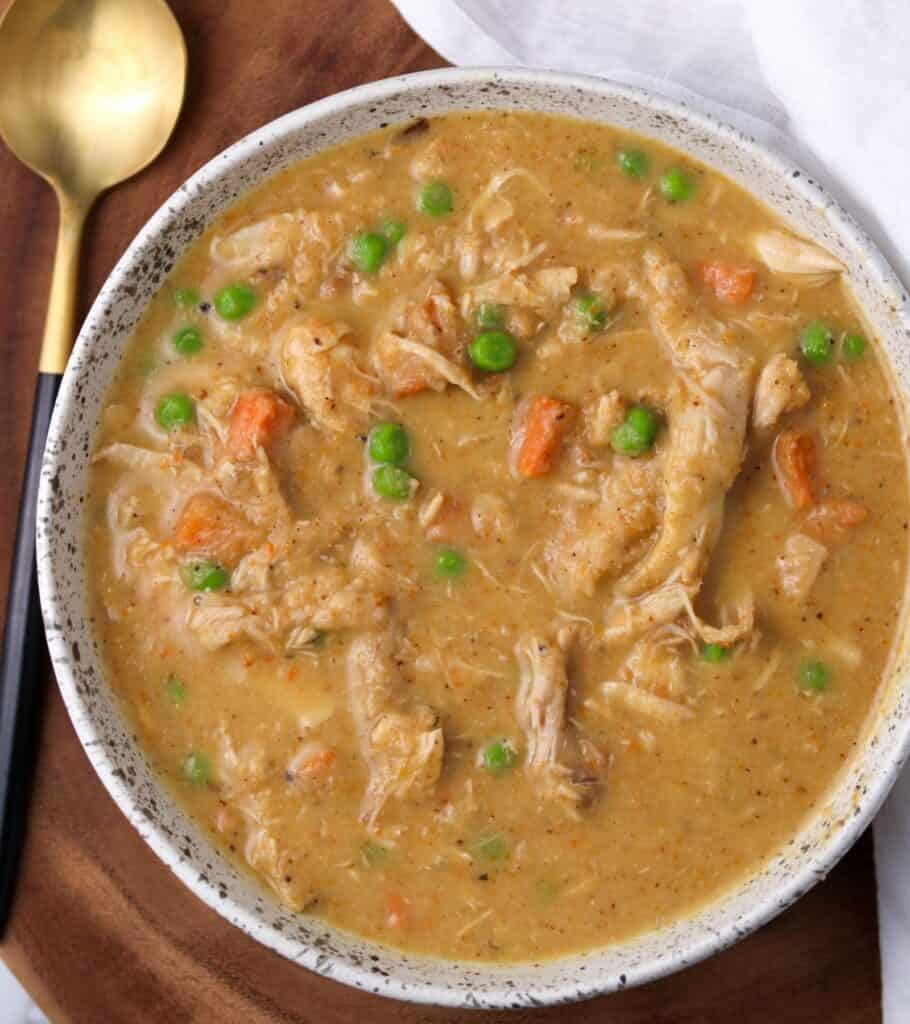 white bowl with cauliflower chicken soup inside