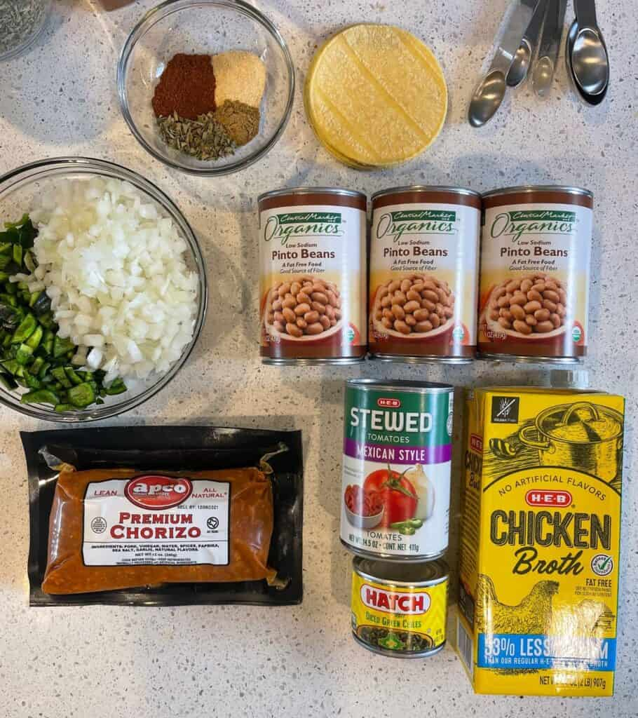 all the ingredients for pinto bean soup on a countertop